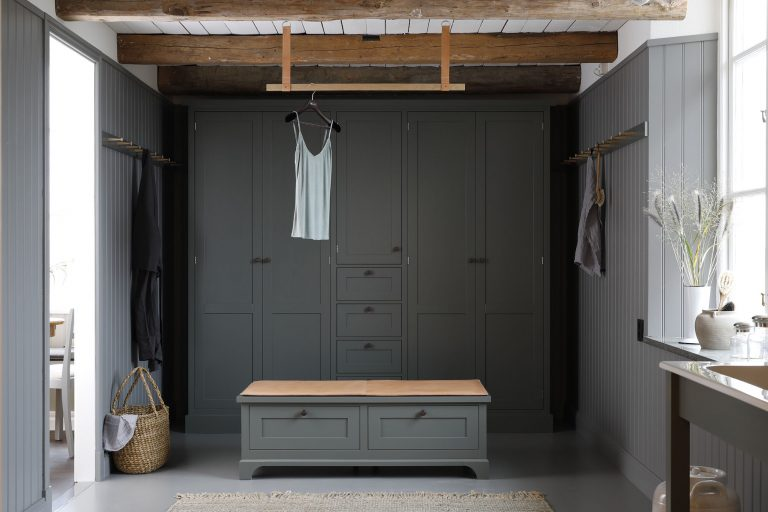 Built-In Storage, Wood Paneling, and a Double Sink