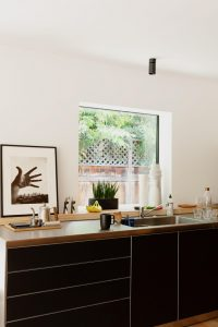 small galley kitchen doubles as the family study